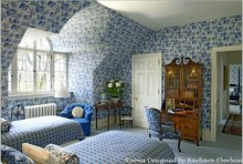 Beautiful, wallpapered, dormered bedroom-designed by Barbara Eberlein