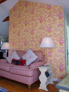By accenting this wall in our cottage we added a sense of height and space to the room