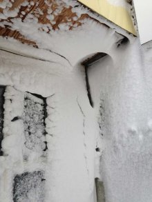 This past winter snow blew through gaps in overhang, through stud cavity and six feet into the structure where it melted and dripped through the ceiling