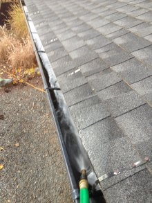 Rinse gutter with hose and check for leaks.