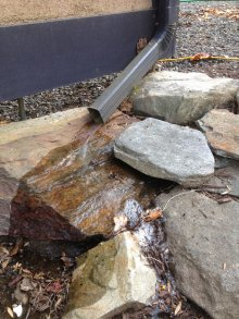 Route downspout away from structure and use a splash block.
