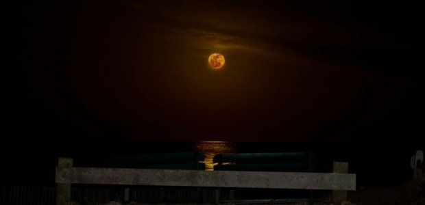 Moon with orange particulates