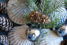 Scallop shells, pine cones, Christmas balls and greenery