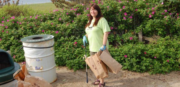 Nantucket Clean Team veteran Dr. Sarah Oktay caught in the act of cleaning Codfish Park.