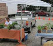 Two of Nantucket's produce growers at Sustainable Nantucket's Farmers & Artisans Market