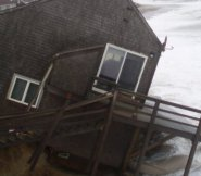 A house on Sheep Pond Road succumbs to ocean storm waves.