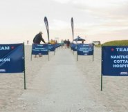 Team support signs line the path to the 2013 event