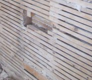 Original lath under walls