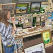 Paintings created on Nantucket by year-round artists are also at Sustainable Nantucket's Farmers & Artisans Market