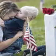 Mother and child near military gravestone